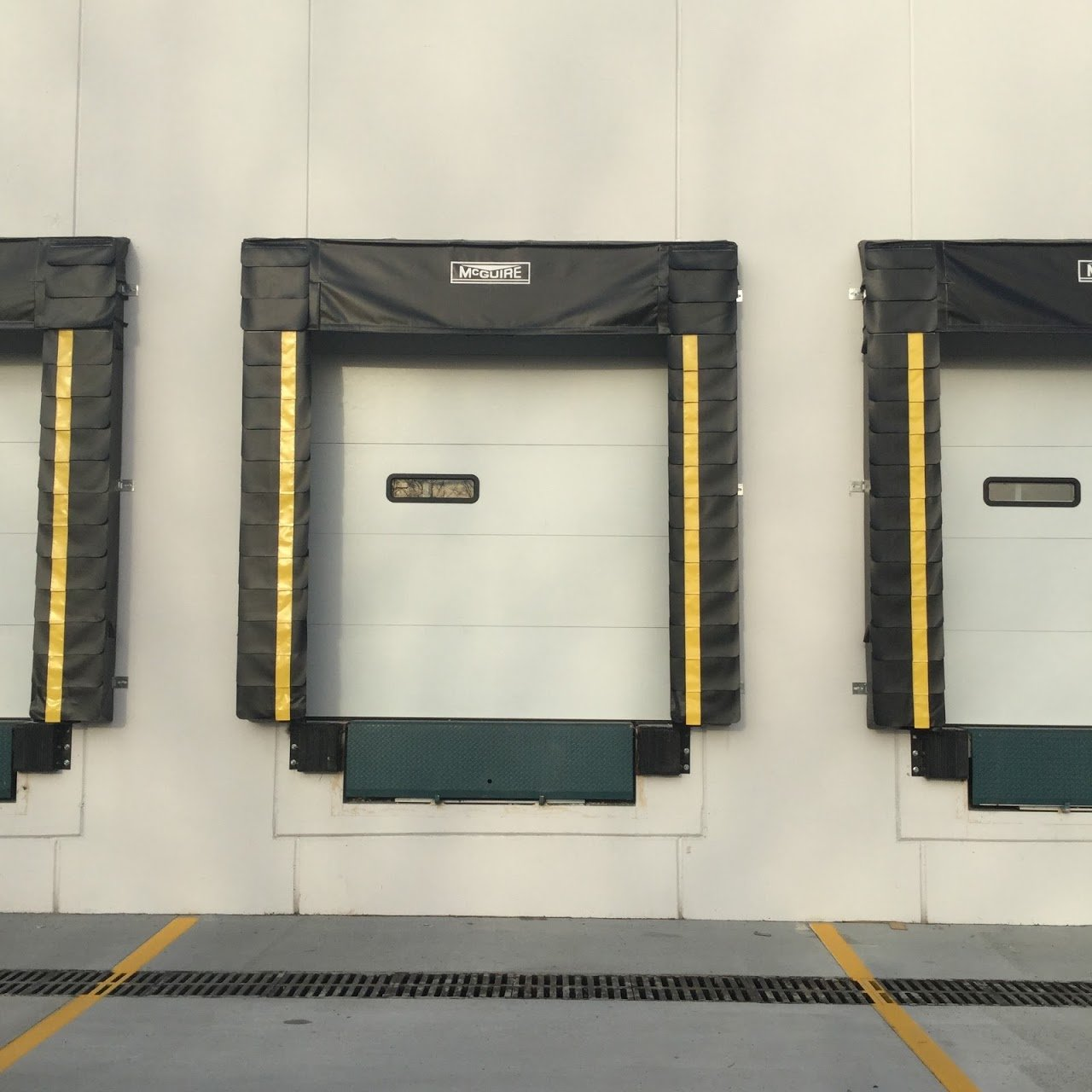 design the loading dock: determine the door sizes, white dock doors with single view panel