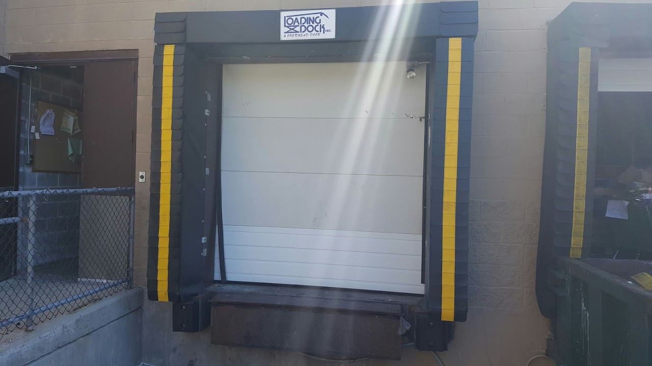 design the loading dock: determine the door sizes, small white dock door by Loading Dock, Inc.