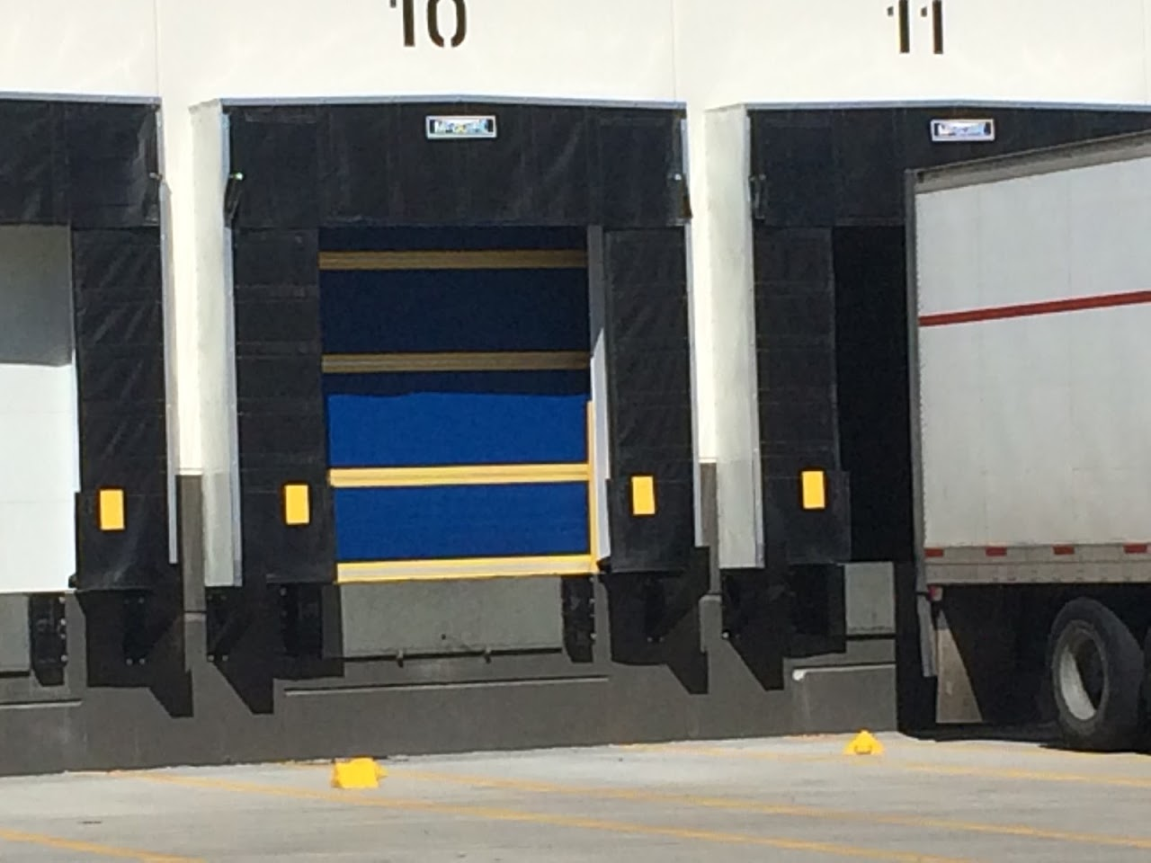 design the loading dock: determine the door, loading dock door with dock seal