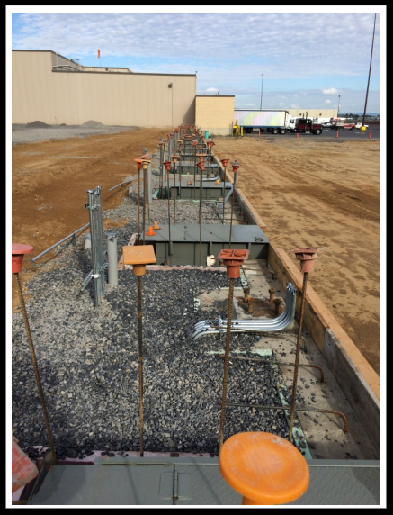 vertical storage leveler installation for cold storage facilities Installation; 2nd picture Back fill with Gravel prior to Floor Pour.