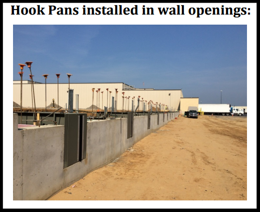 vertical storage leveler installation for cold storage facilities Installation; Hook Pans installed in wall openings.