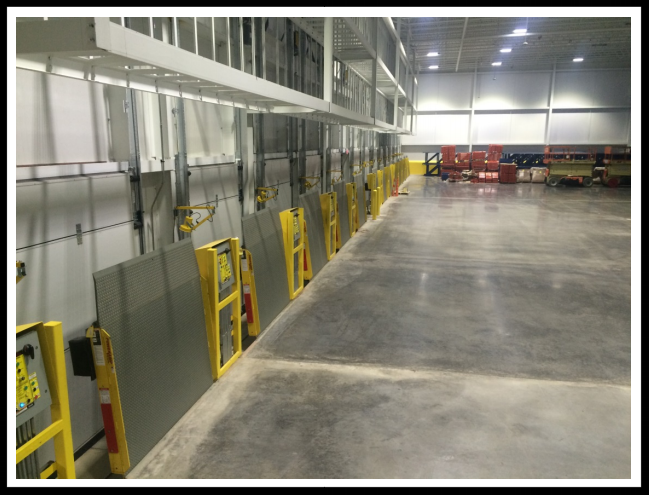 vertical storage leveler installation for cold storage facilities Installation; Stanchion Installation 3rd pic.