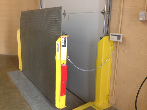 vertical storage leveler installation for cold storage facilities Installation; Poweramp Vertical storage rear view.